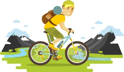 Young bicyclist man riding a bike on mountain background
