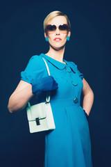 Stylish woman in retro blue fashion
