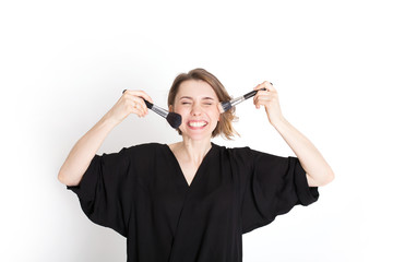 Happy woman makeup artist with brush isolated