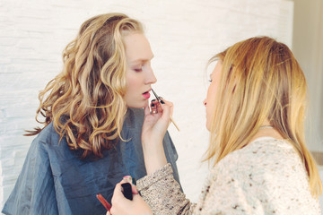 makeup artist doing creative make up of fashion  model