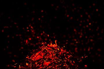 red sparks on a black background