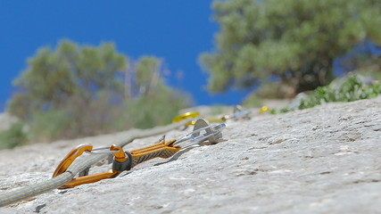 Caucasian person rock climbing