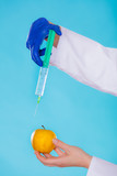 Injection into red apple, genetic modification concept poster
