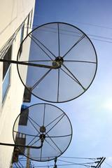 Satellite dish on blue sky.