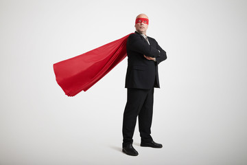 senior businessman dressed as a superhero