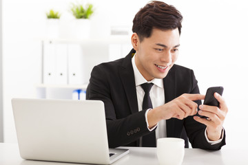 happy Young businessman working with smart phone
