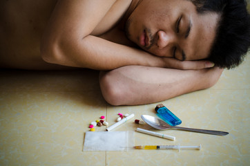 drug addict laying on floor