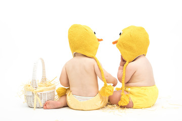 Two Easter Babies Sitting Backwards