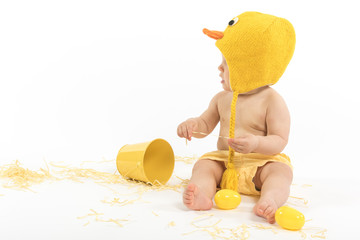 Baby in Easter Chicken Costume Looking Aside