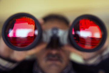 Man with binoculars.