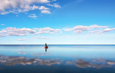 Fishing in blue sea