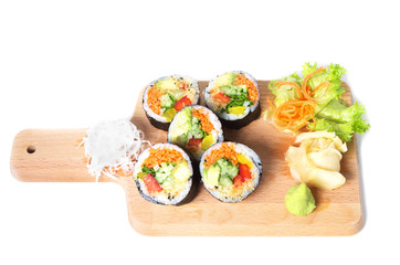 Set of vegetarian sushi rolls on a wooden plate isolated on whit