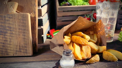 Delicious takeaway burger with cold drink and fries