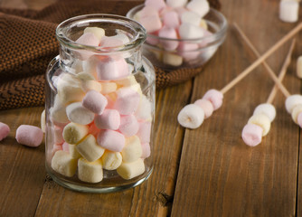 Sweet marshmallows in a glass jar.