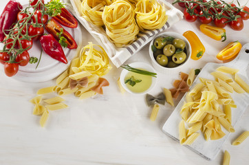 Healthy Italian food ingredients on a whiete wooden background.