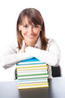 Smiling woman with textbooks, over white
