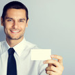 Businessman with blank businesscard