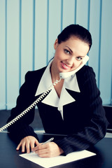 Businesswoman with phone signing document
