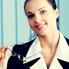 Happy smiling brunette businesswoman at office