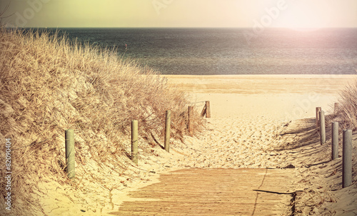 Retro toned photo of a beach path. - 82090404