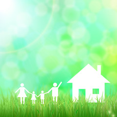 Family holding hands. House. Green grass.