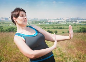 Beautiful plus size woman in sportswear making refuse gesture