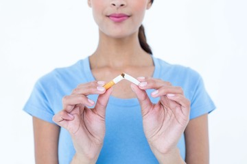 Pretty woman breaking a cigarette