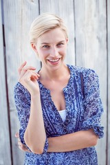 Pretty blonde woman smiling at the camera