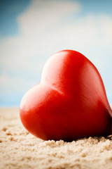 Heart on the sand on the seashore.