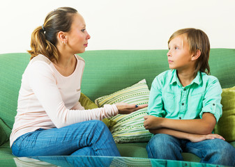 boy and  mother having serious talking