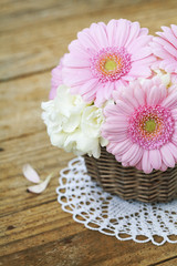 Bouquet of pink gerberas on wooden table