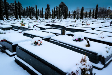 Snowing in the cemetery