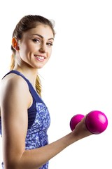Fit woman lifting pink dumbbell