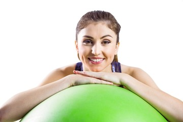 Fit woman leaning on exercise ball
