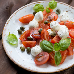 Close-up of caprese salad with capers, selective focus
