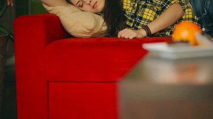 Girl sleeping on the red couch, steadycam shot