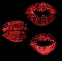 set of red lips imprint isolated on black