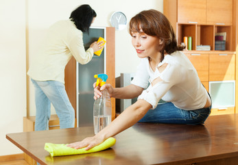 couple together doing cleanup