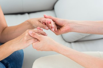 Therapist holding her patients hands