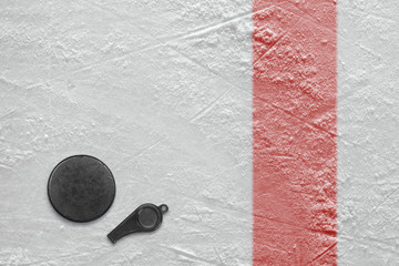 Referee whistle and hockey puck