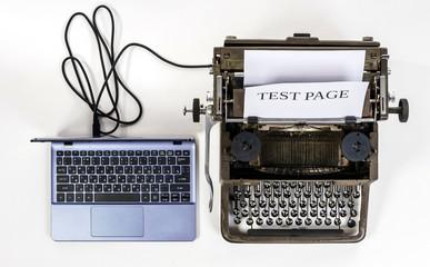 New laptop computer printing page to old vintage typewriter