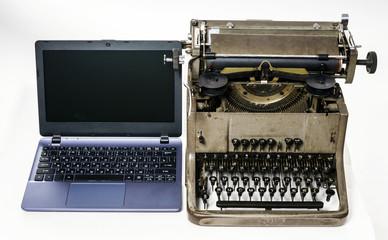 New laptop computer vs old vintage typewriter