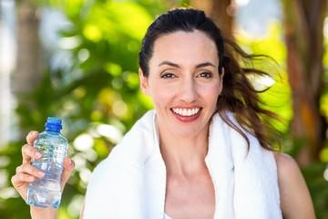 Beautiful brunette holding bottle of water