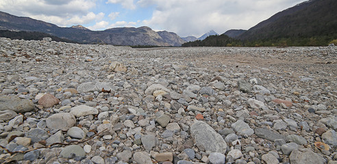 wide gravel bed of the river bed completely without water