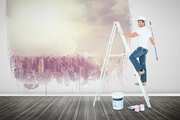 Composite image of happy man on ladder painting with roller