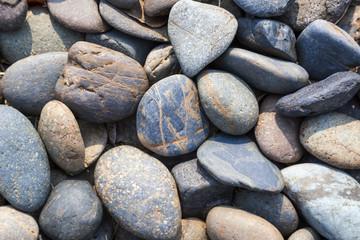 Pebbles stone natural background at seashore