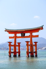 Red sacred torii Itsukushima Shrine in the sea at high tide, Jap