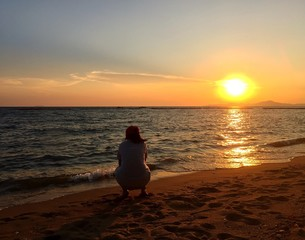 girl sit and see sunset.