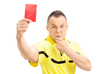 Furious football referee showing a red card