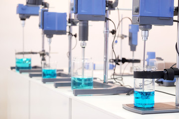 Laboratory equipment. Blue chemical substance in the beaker.